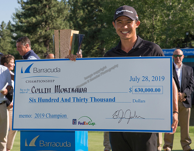 Collin Morikawa with the check after winning  the Barracuda Championship PGA golf tournament at Montrêux Golf and Country Club in Reno, Nevada on Sunday, July 28, 2019.