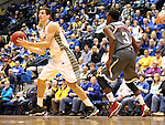 BROOKINGS, SD - JANUARY 18:  Brayden Carlson #12 from South Dakota State University passes the ball away from the defense of Devin Patterson #3 from Omaha in the first half of their Summit League game Saturday afternoon at Frost Arena in Brookings. (Photo by Dave Eggen/Inertia)