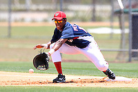 GCL Nationals Arialdi Peguero #15 takes a throw during a game against the GCL Mets at the Washington Nationals Minor League Complex on June 20, 2011 in Melbourne, Florida.  The Nationals defeated the Mets 5-3.  (Mike Janes/Four Seam Images)