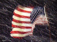 The American flag flasp in a blizzard as it sits atop a drilling rig in the Beluga Gas Field.