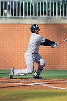 Leon Byrd (1) of the Rice Owls follows through on his swing against the Charlotte 49ers at Hayes Stadium on March 6, 2015 in Charlotte, North Carolina.  The Owls defeated the 49ers 4-2.  (Brian Westerholt/Four Seam Images)
