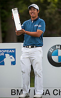 24.05.2015. Wentworth, England. BMW PGA Golf Championship. Final Round. Byeong Hun An [KOR] with his trophy as he wins the BMW PGA with a score of 21 under par.