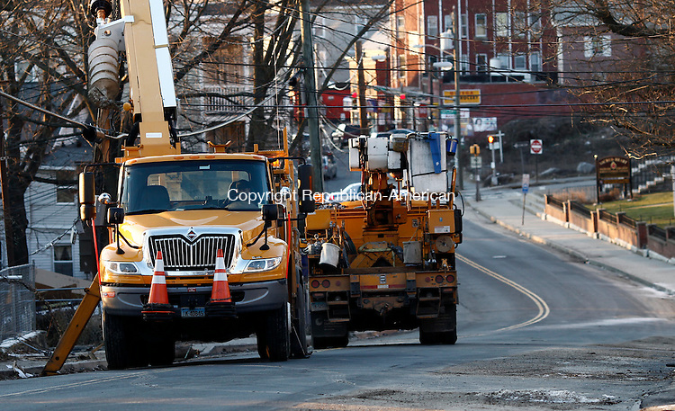 Waterbury, CT- 27 December 2013-122713CM01-  Connecticut Light and Power trucks prepare to replace a damaged utility pole, after a car crash near the intersection of Wolcott and Howard Streets in Waterbury Friday afternoon .   Christopher Massa Republican-American