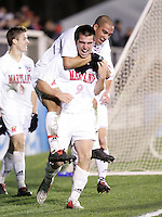 Maryland's Jason Garey (9) gives A.J. Godbolt a ride after scoring Maryland's second goal at 46:41. The University of Maryland Terrapins defeated the Southern Methodist University Mustangs 4-1 in a Men's College Cup Semifinal at SAS Stadium in Cary, NC, Friday, December 9, 2005.