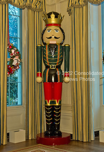 A large nutcracker stands in the State Dining Room as part of the 2015 White House Christmas theme &quot;A Timeless Tradition&quot; at the White House in Washington, DC on Wednesday, December 2, 2015.  The decorations include a six foot teddy bear and hundreds of vintage nutcrackers.<br /> Credit: Ron Sachs / CNP