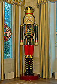 """A large nutcracker stands in the State Dining Room as part of the 2015 White House Christmas theme """"A Timeless Tradition"""" at the White House in Washington, DC on Wednesday, December 2, 2015.  The decorations include a six foot teddy bear and hundreds of vintage nutcrackers.<br /> Credit: Ron Sachs / CNP"""