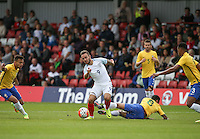 Adam Armstrong (Barnsley, loan from Newcastle United) of England shakes off a challenge during the International match between England U20 and Brazil U20 at the Aggborough Stadium, Kidderminster, England on 4 September 2016. Photo by Andy Rowland / PRiME Media Images.