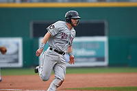 Wisconsin Timber Rattlers catcher David Fry (10) hustles towards home plate during a Midwest League game against the Lansing Lugnuts at Cooley Law School Stadium on May 1, 2019 in Lansing, Michigan. Wisconsin defeated Lansing 8-3 after the game was suspended from the previous night. (Zachary Lucy/Four Seam Images)