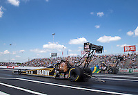 Jun. 2, 2013; Englishtown, NJ, USA: NHRA top fuel dragster driver Tony Schumacher (near lane) races alongside Sidnei Frigo during the Summer Nationals at Raceway Park. Mandatory Credit: Mark J. Rebilas-