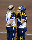Michigan Wolverines Softball pitcher Megan Betsa (3) and catcher Lauren Sweet (25) during a game against the University of South Florida Bulls on February 8, 2014 at the USF Softball Stadium in Tampa, Florida.  Michigan defeated USF 3-2.  (Copyright Mike Janes Photography)