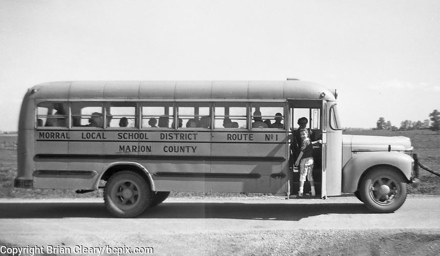 Children board a Marion County , Ohio School Bus to go to school in Morrall , Ohio, circa 1940's.  (Photo by bcpix.com)