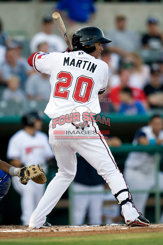 Frisco Roughriders outfielder Leonys Martin #20 at bat during the Texas League All Star Game played on June 29, 2011 at Nelson Wolff Stadium in San Antonio, Texas. The South All Star team defeated the North All Star team 3-2. (Andrew Woolley / Four Seam Images)