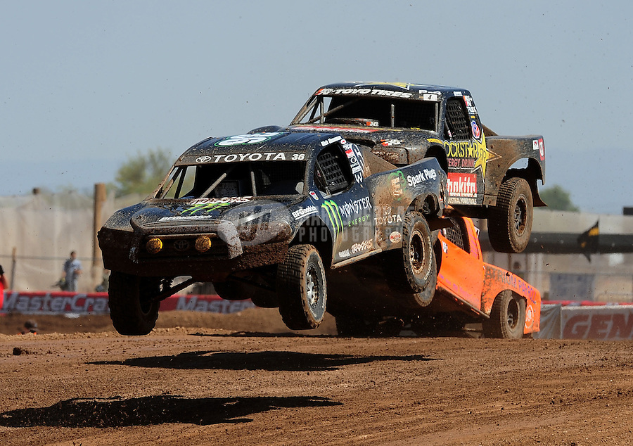 Apr 17, 2011; Surprise, AZ USA; LOORRS driver Rick Huseman (36) leads Todd Leduc (4) during round 4 at Speedworld Off Road Park. Mandatory Credit: Mark J. Rebilas-