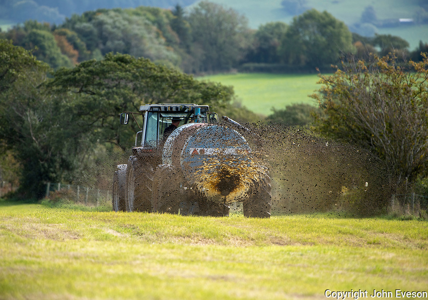 Spreading slurry on silage aftermath, near Preston, Lancashire.