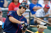 Minnesota Twins catcher Joe Mauer #7 on deck during a Major League Baseball game against the Texas Rangers at the Rangers Ballpark in Arlington, Texas on July 27, 2011. Minnesota defeated Texas 7-2.  (Andrew Woolley/Four Seam Images)