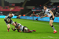 George North of Ospreys is tackled by Paula Balekana of Zebre during the Guinness Pro14 Round 10 match between the Ospreys and Zebre at the Liberty Stadium in Swansea, Wales, UK.  Friday 30 November 2018
