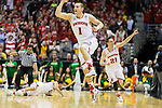 Wisconsin Badgers Ben Brust (1) and Josh Gasser (21) celebrate their victory during the third-round game in the NCAA college basketball tournament against the Oregon Ducks Saturday, April 22, 2014 in Milwaukee. The Badgers won 85-77. (Photo by David Stluka)