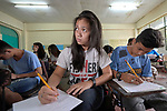 Students in an Alternative Learning System class, sponsored by the Kapatiran-Kaunlaran Foundation (KKFI), in the Tondo neighborhood of Manila, Philippines. <br /> <br /> KKFI is supported by United Methodist Women.
