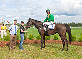 Black Jack Blues in the winner's circle after the Carolina Cup. With trainer Joe Delozier and jockey Ross Geraghty.