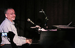 Marc Shaiman performing at the Seth Rudetsky Book Launch Party for 'Seth's Broadway Diary' at Don't Tell Mama Cabaret on October 22, 2014 in New York City.