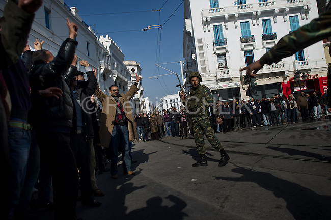"© Remi OCHLIK/IP3 - Tunis the 17 january 2011 Tunisia took a step toward democracy and reconciliation Monday, promising to free political prisoners and opening its government to opposition forces long shut out of power -- but the old guard held onto the key posts, angering protesters..Demonstrators carrying signs reading ""GET OUT! demanded that the former ruling party be banished altogether -- a sign more troubles lie ahead for the new unity government as security forces struggle to contain violent reprisals, shootings and looting three days after the country's longtime president fled under pressure from the streets."