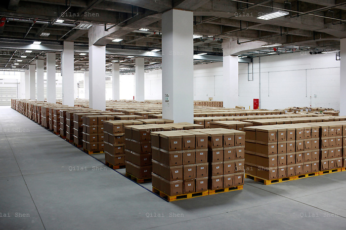"""A view of  the Yihaodian warehouse and logistics center in Shanghai, China on 23 August, 2011. As online supermarkets is attracting a rapidly increasing number of young consumers, especially women, U.S. giant Walmart has acquired a minority stake in Yihaodian, or """"The Store"""", a young but very successful E-Commerce company that sells and delivers everything from food, daily household  items, electronics, and clothing."""