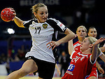 BELGRADE, SERBIA - DECEMBER 15:  Ekaterina Andryushina of Russia (L)  in action against Laerke Moller (R) of Denmark during the Women's European Handball Championship 2012 fifth place match between Denmark and Russia at Arena Hall on December 15, 2012 in Belgrade, Serbia. (Photo by Srdjan Stevanovic/Getty Images)