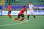 The Hague, Netherlands, June 10: Jonghyun Jang #25 of Korea looks to pass during the field hockey group match (Men - Group B) between Germany and Korea on June 10, 2014 during the World Cup 2014 at Kyocera Stadium in The Hague, Netherlands. Final score 6-1 (3-0) (Photo by Dirk Markgraf / www.265-images.com) *** Local caption ***