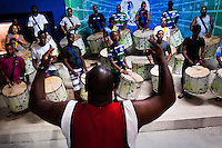 Rocinha samba school drummers (bateria) rehearse their Carnival music song at the school's quadra (samba court) in Rocinha, Rio de Janeiro, Brazil, 17 February 2012.