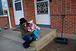 "Kendrick Brinson.LUCEO..Adrianne Ireland sits on the front porch with her daughter Sloan, 3, outside of her family's apartment in oil boom-town Williston, North Dakota in January 2012..Adrianne temped at Precision Drilling last year, but now bartends at a popular bar called Whispers..The population of Williston has almost doubled since Adrianne was in high school, she said, and milk prices have gone up with population..Adrianne's mother, Peggy Adrin said the town has ""really changed a lot"" since she first moved there 30 years ago. ""When we first moved here, there was nothing,"" she said. Williston, North Dakota is currently experiencing an influx of people relocating there for the town's third oil boom...Model Released: Yes.Assigning Editor: Michael Wichita."