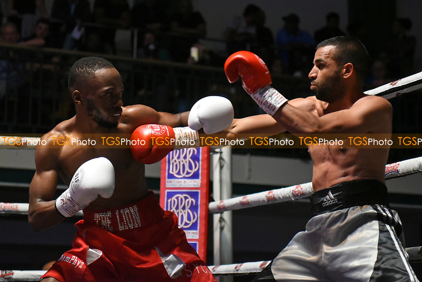 Ryan Walker (red shorts) defeats Stefan Sashev during a Boxing Show at York Hall on 7th September 2019