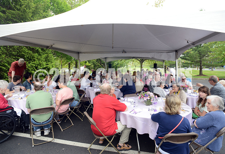 Participants enjoy each other's company during a Mother's Day luncheon on the grounds of Spring Village at Floral Vale for their patients and their families Saturday May 9, 2015 in Yardley, Pennsylvania. (Photo by William Thomas Cain/Cain Images)
