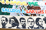 """22 JUN 2010: A sign is displayed over a Mexico flag, reading """"Vamos Mexico - Saludos a San Luis"""" and bearing the images of Mexico players. The Mexico National Team played the Uruguay National Team at Royal Bafokeng Stadium in Rustenburg, South Africa in a 2010 FIFA World Cup Group A match."""