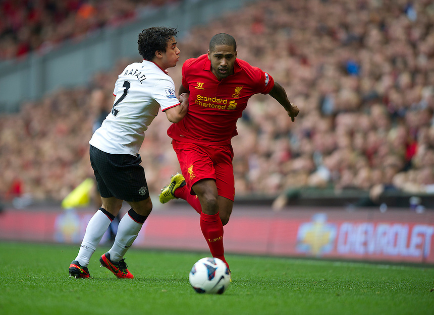 Liverpool's Glen Johnson brushes past Manchester United's Rafael ..Football - Barclays Premiership - Liverpool v Manchester United - Sunday 23rd September 2012 - Anfield - Liverpool..