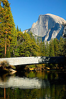 The bridge over Merecd River with Half Dome in the background, Yosemite National Park, California.