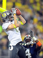 Jan 10, 2011; Glendale, AZ, USA; Oregon Ducks wide receiver Jeff Maehl (23) scores a two-point conversion over Auburn Tigers safety Zac Etheridge (4) during the fourth quarter of the 2011 BCS National Championship game at University of Phoenix Stadium.  Mandatory Credit: Mark J. Rebilas-