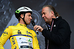 Race leader Yellow Jersey Edvald Boasson Hagen (NOR) Team Dimension Data at sign on for Stage 2 of the Criterium du Dauphine 2019, running 180km from Mauriac to Craponne-sur-Arzon, France. 9th June 2019<br /> Picture: ASO/Alex Broadway | Cyclefile<br /> All photos usage must carry mandatory copyright credit (© Cyclefile | ASO/Alex Broadway)