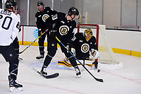 September 15, 2017: Boston Bruins goalie Anton Khudobin (35) protects the net from left defenseman Jeremy Lauzon (79) during the Boston Bruins training camp held at Warrior Ice Arena in Brighton, Massachusetts. Eric Canha/CSM