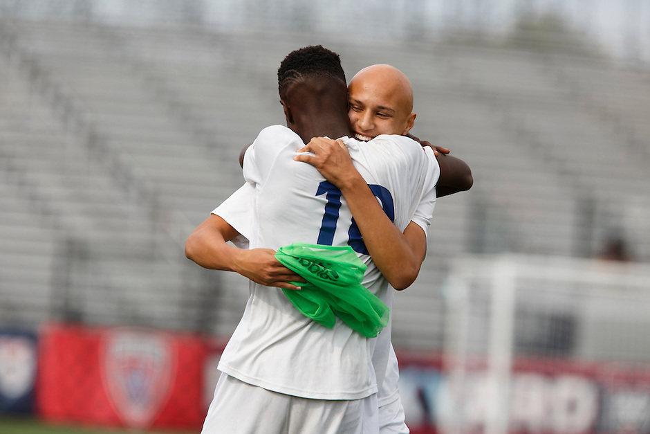 Mishawaka Marian's Gabriel Martinez hugs teammate Jordan Morris (10) as Martinez replaces Morris on the field during the IHSAA Class A Boys Soccer State Championship Game against Providence on Saturday, Oct. 29, 2016, at Carroll Stadium in Indianapolis. Marian won 4-0. Special to the Tribune/JAMES BROSHER