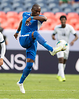 DENVER, CO - JUNE 19: Jean-Sylvain Babin #6 controls the ball during a game between Martinique and Cuba at Broncos Stadium on June 19, 2019 in Denver, Colorado.