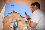Workshop administrator, liaison and photographer Martín Vargas photographs the bell tower at Mission San Antonio de Padua, California,..Photographed during the 3rd Al Weber Mission Portfolio Workshop, April 2011.
