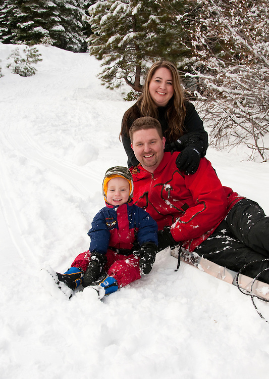 California, Lake Tahoe: Young family with child enjoy snow play with sled at North Lake Tahoe Regional Park.  Photo copyright Lee Foster.  Photo # cataho107648