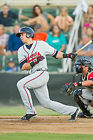Joey Meneses (34) of the Rome Braves follows through on his swing against the Kannapolis Intimidators at CMC-Northeast Stadium on August 24, 2013 in Kannapolis, North Carolina.  The Intimidators defeated the Braves 6-1.  (Brian Westerholt/Four Seam Images)