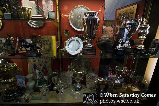Glentoran 2 Cliftonville 1, 22/10/2016. The Oval, NIFL Premiership. Club secretary Ricky Rea adjusts the trophy cabinet display in the boardroom at The Oval, Belfast, pictured before Glentoran hosted city-rivals Cliftonville in an NIFL Premiership match. Glentoran, formed in 1892, have been based at The Oval since their formation and are historically one of Northern Ireland's 'big two' football clubs. They had an unprecendentally bad start to the 2016-17 league campaign, but came from behind to win this fixture 2-1, watched by a crowd of 1872. Photo by Colin McPherson.
