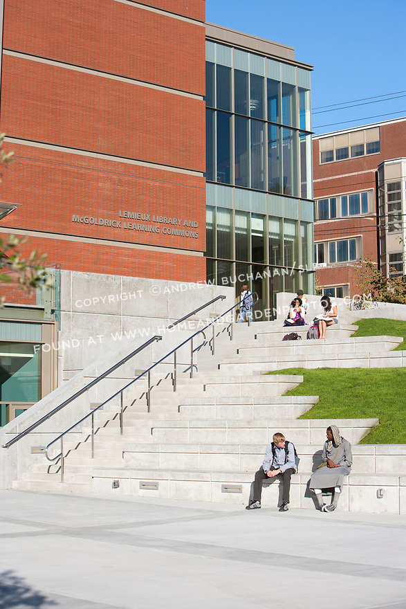 People outside Seattle University's Lemieux Library on a sunny day.