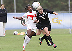 03 November 2010: Duke's Libby Jandl (right) and Maryland's Jasmyne Spencer (left). The Maryland Terrapins defeated the Duke Blue Devils 1-0 in an ACC Women's Soccer Tournament quarterfinal game at Koka Booth Stadium at WakeMed Soccer Park in Cary, NC.