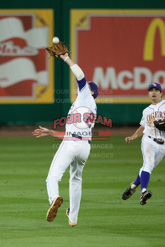 LSU Tigers second baseman JaCoby Jones #23 makes a tough catch against the Mississippi State Bulldogs during the NCAA baseball game on March 16, 2012 at Alex Box Stadium in Baton Rouge, Louisiana. LSU defeated Mississippi State 3-2 in 10 innings. (Andrew Woolley / Four Seam Images)