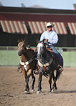 Nick Uhart rides with a rider-less horse honoring his father Loran Uhart during the Minden Ranch Rodeo at the NV150 Fair at Fuji Park, in Carson City, Nev., on Saturday, Aug. 2, 2014.<br /> Photo by Cathleen Allison