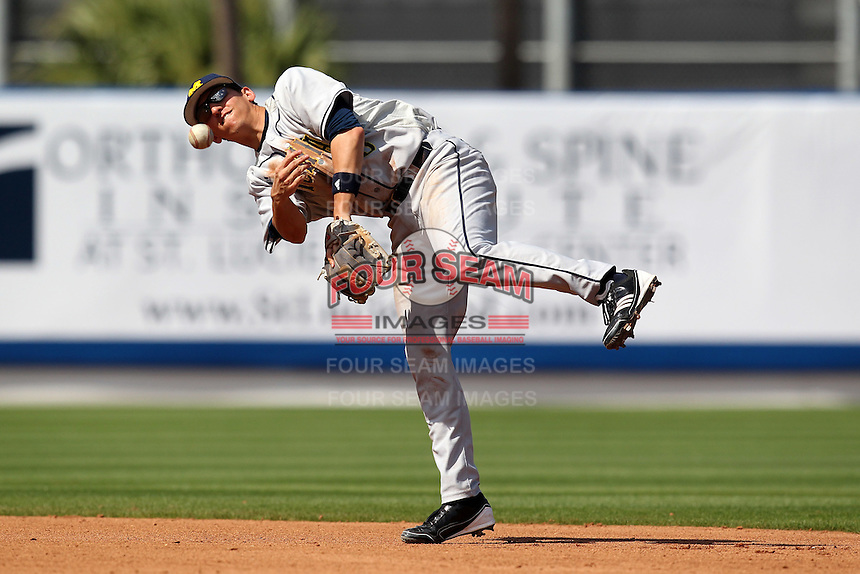 Anthony Toth #5 of the Michigan Wolverines throws to first vs the New York Mets in an exhibition game at Digital Domain Ballpark in Port St Lucie, Florida;  February 27, 2011.  New York defeated Michigan 7-1.  Photo By Mike Janes/Four Seam Images