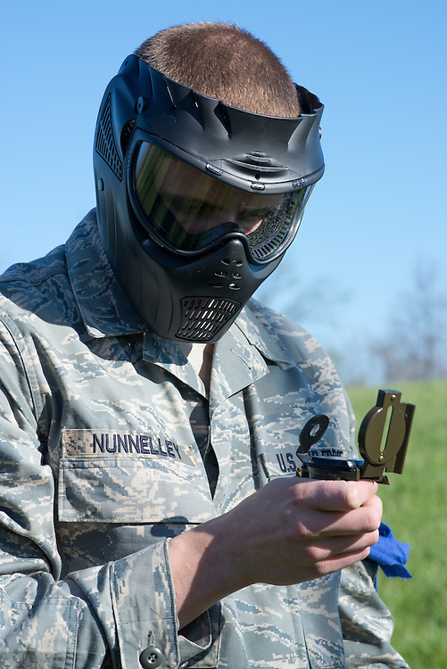 After recieving additional intell, cadet nunnelley uses a compas to find the direction of his team's next checkpoint during the Airforce ROTC's mobile exercise on April 16, 2016. Photo by Ohio University / Kaitlynn Stone